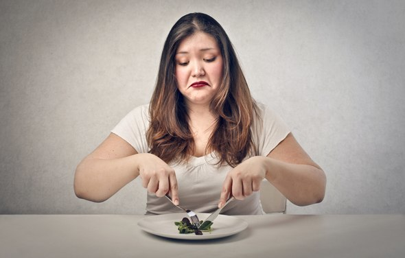 Overweight Woman Eating Salad