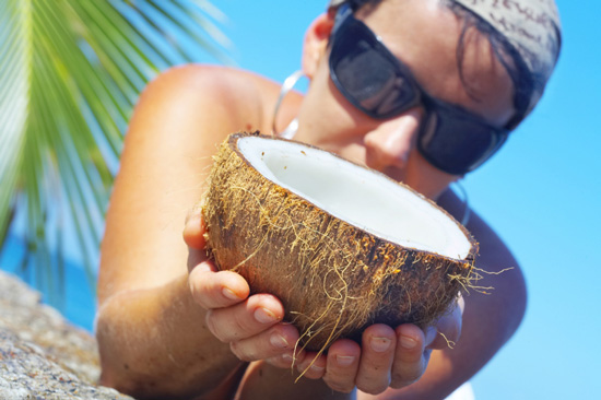 Woman Holding an Open Coconut