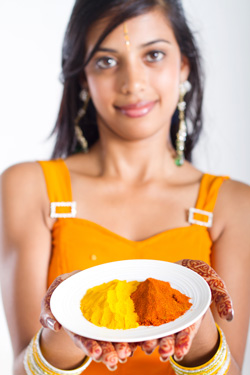 Young Indian Woman Holding Spices