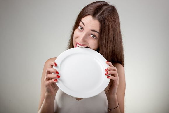 Beginner Fasting Woman Biting Plate