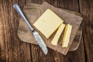 butter-and-knife-on-wooden-chopping-board