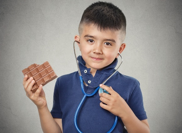 Child With Chocolate and Stethoscope