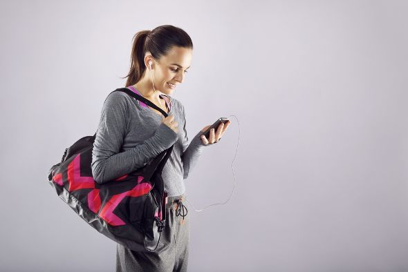 Fit Woman Holding Gym Bag And Phone