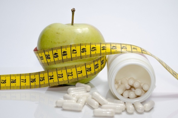 Green Apple Pill Bottle And Measuring Tape