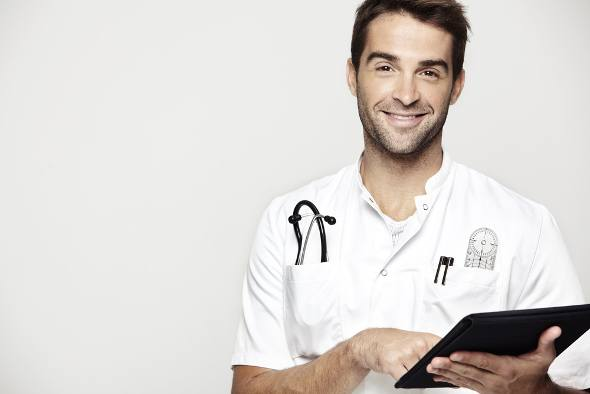 male-doctor-holding-clipboard