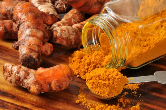 Turmeric Roots and a Jar of Turmeric Powder