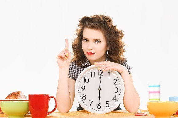 Woman With Clock Wagging Finger