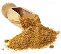 Large Wooden Spoon Filled With Turmeric Powder