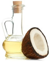 Bottle of Coconut Oil and Half a Coconut