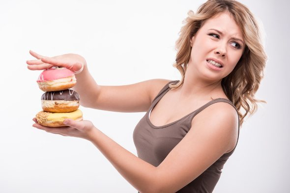 Young-Woman-Disgusted-By-Doughnuts